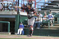 Catcher Matt Klein #6 of the Lansing Lugnuts gives signals against the Burlington Bees at Community Field on July 27, 2014 in Burlington, Iowa. The Lugnuts won 3-2.   (Dennis Hubbard/Four Seam Images)