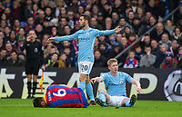 Kevin De Bruyne of Manchester City points to injured Scott Dann of Crystal Palace to try & get help for the injury during the Premier League match between Crystal Palace and Manchester City at Selhurst Park, London, England on 31 December 2017. Photo by Andy Rowland.