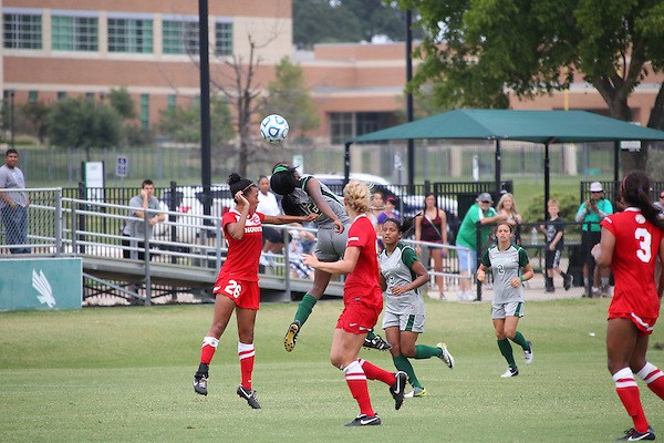 Denton, TX - AUGUST 31:  Amber Haggerty #12 of the North Texas Mean Green soccer in action against University of Houston Cougars at the Mean Green Village Soccer Field on August 31, 2012 in Denton, Texas. NT won 2-1.(Photo by Rick Yeatts)