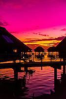Overwater bungalows at twilight, Hilton Moorea Lagoon Resort, island of Moorea, French Polynesia.
