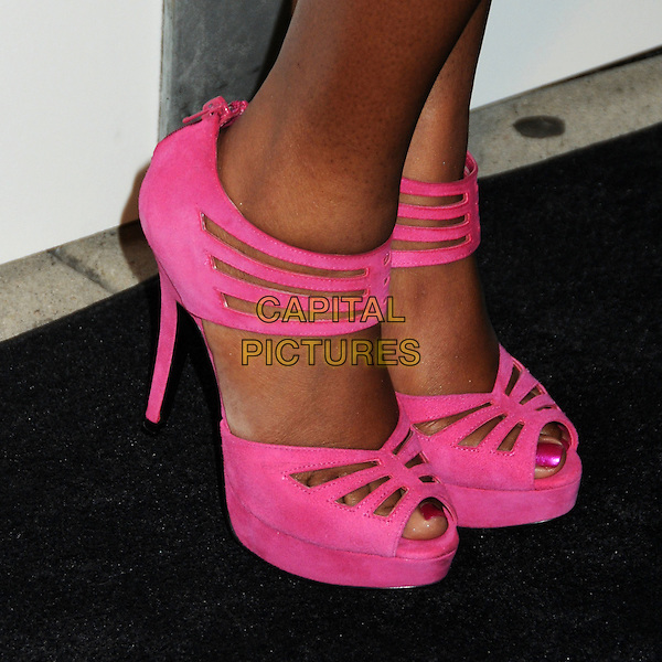 "NATURI NAUGHTON's shoes .Interscope Geffen A&M Records 4th Annual ""Creme of the Crop"" Post BET Awards 2010 Celebration held at Mr. Chow Restaurant,  Beverly Hills, California, USA, 27th June 2010..detail pink cut out platform shoes heels  .CAP/ADM/BP.©Byron Purvis/AdMedia/Capital Pictures."
