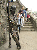 visitors pass beside bronze sculptures of spanish soldiers,  in Manila's Intramuros<br /> Photo : (c) by Pierre Roussel/ IMAGES DISTRIBUTION