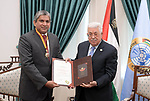 Palestinian President Mahmoud Abbas honors the Sri Lankan Ambassador in the West Bank city of Ramallah, on March 11, 2019. Photo by Thaer Ganaim