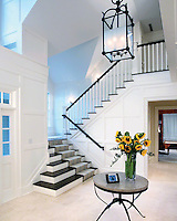 Contemporary Open Foyer With Lutron Lighting