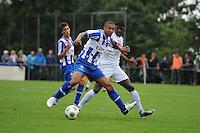 VOETBAL: OUDEGA (W): Sportpark It Joo, 17-07-2012, Oefenwedstrijd SC Heerenveen-Waasland Beveren (BEL), Gianni Zuiverloon (#2), Alain Pierre Mendy (#17), ©foto Martin de Jong