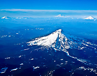 Mt St Helens,Mt Rainer, Mt Adams and Mt Hood in foreground in the Pacific Cascade Mountain Range in Oregon and Washington photographed from the air (aerial).