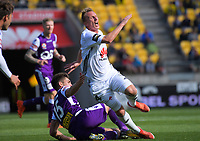Goran Paracki goes down in a challenge from Brandon Wilson during the A-League football match between Wellington Phoenix and Perth Glory at Westpac Stadium in Wellington, New Zealand on Sunday, 12 November 2017. Photo: Dave Lintott / lintottphoto.co.nz