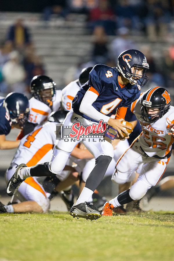 Owen White (4) of the Carson Cougars runs with the football during second half action against the Northwest Cabarrus Trojans at Jesse Carson High School on October 24, 2014, in China Grove, North Carolina.  The Cougars defeated the Trojans 35-6.  (Brian Westerholt/Sports On Film)