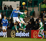 Danny Wilson heads clear of Simon Murray