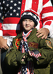 Summer McGill, 8, and her dad Bryan watch the annual Veterans Day parade in Virginia City, Nev., on Wednesday, Nov. 11, 2015. <br /> Photo by Cathleen Allison