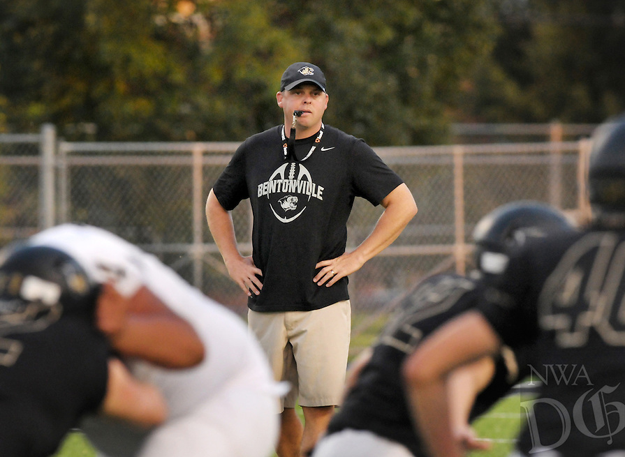 NWA Democrat-Gazette/BEN GOFF @NWABENGOFF<br /> Jody Grant, new Bentonville head coach, looks on as the varsity offense and defense scrimmage on Saturday Aug. 22, 2015 at Tiger Pride night in Bentonville's Tiger Stadium.