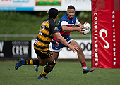 Tevita Hala makes arun at Pat Masoe. Counties Manukau Premier 1 McNamara Cup Final between Ardmore Marist and Bombay, played at Navigation Homes Stadium on Saturday July 20th 2019.<br />  Bombay won the McNamara Cup for the 5th time in 6 years, 33 - 18 after leading 14 - 10 at halftime.<br /> Photo by Richard Spranger.