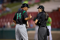Dayton Dragons manager Luis Bolivar (14) argues a call with umpires A.J. Choc (hidden) and Emma Charlesworth-Seiler during a Midwest League game against the Kane County Cougars on July 20, 2019 at Northwestern Medicine Field in Geneva, Illinois.  Dayton defeated Kane County 1-0.  (Mike Janes/Four Seam Images)