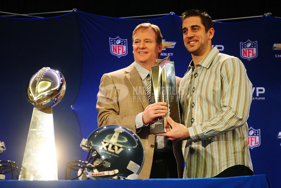 February 7, 2011; Dallas, TX, USA; Green Bay Packers quarterback Aaron Rodgers (right) is presented with the MVP trophy from NFL commissioner Roger Goodell during the MVP and coach press conference at the Super Bowl XLV media center. Mandatory Credit: Mark J. Rebilas-