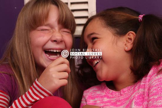 Young friends sharing a joke