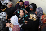 "The mother of Palestinian Ahmad Najjar, 20, who was shot dead by Israeli soldiers, mourns during his funeral in the West Bank village of Burin near Nablus, February 1, 2015. Israeli soldiers shot dead Najjar on Saturday in the occupied West Bank, the military and a Palestinian security official said. An Israeli military spokeswoman said soldiers saw two Palestinians throwing a fire bomb towards a road near the Palestinian city of Nablus and ""identifying an immediate threat shot toward the suspects' lower extremities"". A Palestinian security source said one of the Palestinians shot by the soldiers was killed, but gave no further details. The Israeli military said it was searching for the second man. Photo by Nedal Eshtayah"