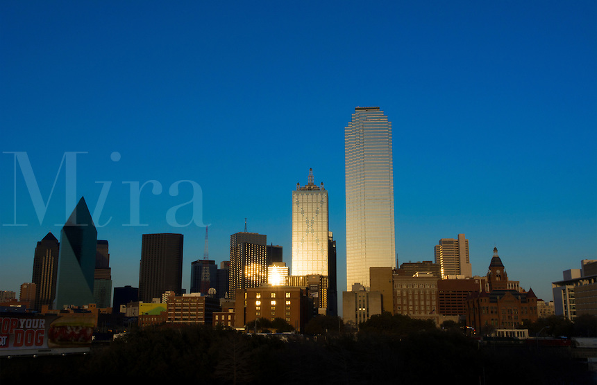 Dallas Texas skyline at sunset of modern skyscrapers in downtown Dallas city across expressway