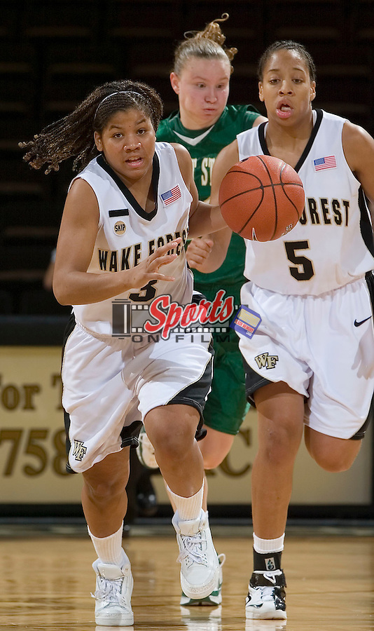 Camille Collier (3) of the Wake Forest Demon Deacons pushes the ball up court versus the Wright State Raiders at the LJVM Coliseum on December 5, 2007 in Winston-Salem, NC.