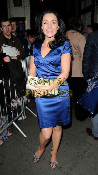 "GUEST.The ""Betty Blue Eyes"" press night, Novello Theatre, London, England..April 13th, 2011.full length blue silk satin dress silver shoes clutch bag.CAP/CAN.©Can Nguyen/Capital Pictures."