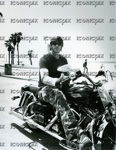 Red Hot Chili Peppers - drummer Chad Smith riding his Harley Davidson in Santa Monica California - July 2002.  Photo by: Tony Woolliscroft