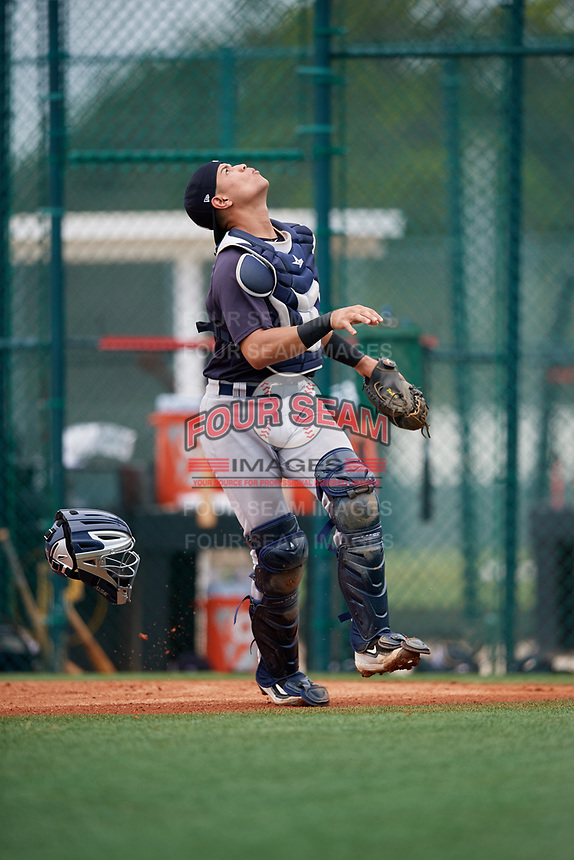 GCL Yankees East catcher Pedro Diaz (55) tracks a pop up during the second game of a doubleheader against the GCL Pirates on July 31, 2018 at Pirate City Complex in Bradenton, Florida.  GCL Pirates defeated GCL Yankees East 12-4.  (Mike Janes/Four Seam Images)