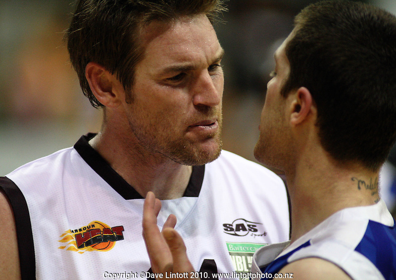 Heat forward Dillon Boucher has a chat with Eric Devendorf during the National Basketball League match between the Wellington Saints and Harbour Heat at TSB Bank Arena, Wellington, New Zealand on Thursday, 29 April 2010. Photo: Dave Lintott / lintottphoto.co.nz