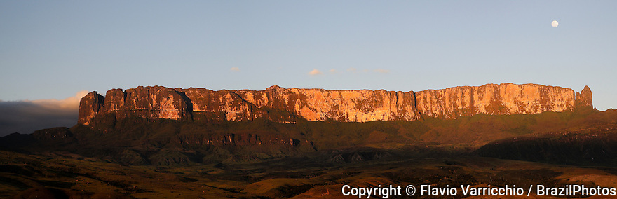 Sunset at Mount Roraima ( also known as Roraima Tepui or Cerro Roraima in Spanish, and Monte Roraima in Portuguese ), is the highest of the Pakaraima chain of tepui plateau in South America. Mount Roraima lies on the Guiana Shield in the southeastern corner of Venezuela's Canaima National Park. The tabletop mountains of the park are considered some of the oldest geological formations on Earth, dating back to some two billion years ago in the Precambrian Era. The mountain includes the triple border point of Venezuela, Brazil and Guyana.