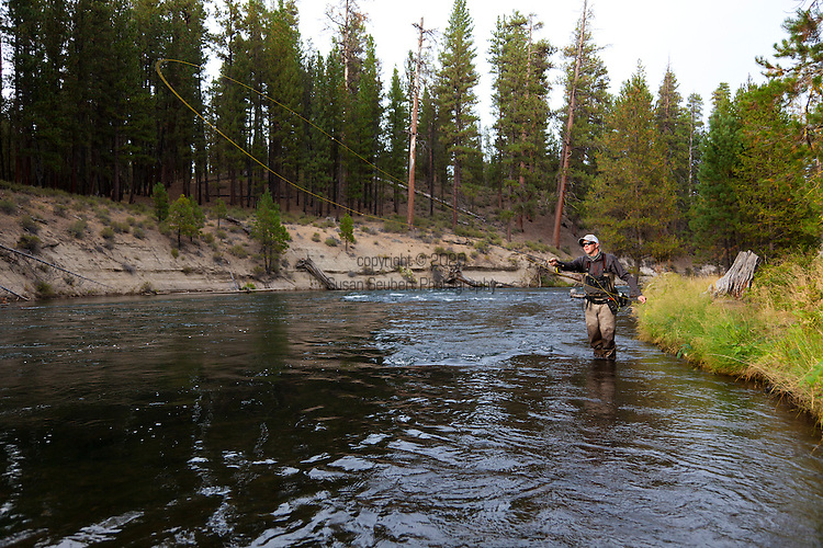 Fly Fishing on the Deschutes River near Bend, Oregon.  Beau Price casting on the river in the late afternoon.