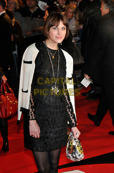 ALEXA CHUNG.The Brit Awards 2008, arrivals.Earl's Court, London, England.20th February 2008.Ref: CAP/PL.brits half length black white jacket polka dot sheer dress necklace bag purse 3/4.www.capitalpictures.com.©Phil Loftus/Capital Pictures.