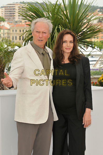 "CLINT EASTWOOD & ANGELINA JOLIE.""The Exchange"" ( formerly titled ""Changeling"" ) photocall at Palais de Festival during the 61st Cannes International Film Festival, Cannes, France. .20th May 2008 .half length black beige cream jacket hand top .CAP/PL.©Phil Loftus/Capital Pictures."