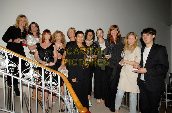 WINNERS - KIRSTY YOUNG, NATALIE MASSANET, CATHY DENNIS, KELLY HOPPEN, GUEST, JAKIE KAY, MEERA SYAL, MARCIA KILGORE, GUEST, NATALIE DEAN & GUEST.The Grazia O2 Awards, Sunbeam Studio, London, .England, July 19th 2007. .half length 3/4 standing on stairs.CAP/FIN.©Steve Finn/Capital Pictures.