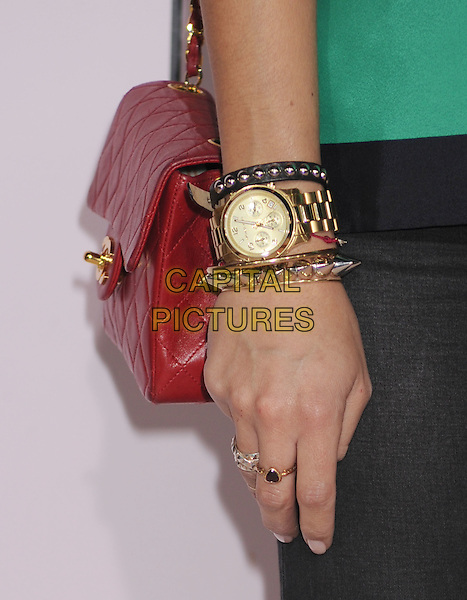 "Ashley Madekwe's hand.""The Vow"" Los Angeles Premiere held at Grauman's Chinese Theatre, Hollywood, California, USA..February 6th, 2012.red bag purse gold bracelet watch.CAP/ROT/TM.©Tony Michaels/Roth Stock/Capital Pictures"