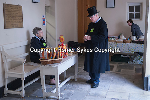 Trinity Hospital Almshouse Greenwich SE London, open day. The almshouse is founded and owned by the City of London Mercers Company. On open day some residents wear their traditional top hats and frock coats. The Almshouse is the oldest building in Greenwich.
