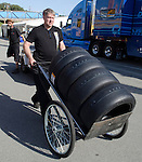 Monterey California, May 4, 2014, Laguna Seca Monterey Grand Prix, Crew member wheels tires through paddock.