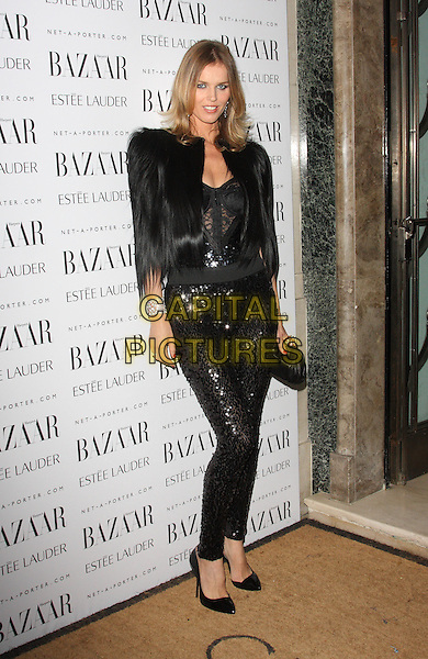 Eva Herzigova.Harpers Bazaar Women of the Year Awards at Claridges Hotel, London, Englnd..November 7th 2011.full length black fur feather jacket shoulder pads jumpsuit sequins sequined lace.CAP/ROS.©Steve Ross/Capital Pictures