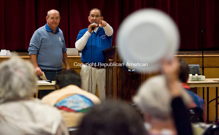 TORRINGTON, CT - 18 OCTOBER 2009 -101809JT02-<br /> Auctioneer Rich Kaufman calls out to a bidder as he and fellow Probus Club member Michael Broverman, along with other members of the club, conduct Sunday's 40th annual Torrington Probus Club Auction at the Coe Park auditorium.<br /> Josalee Thrift Republican-American