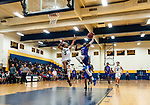 WATERBURY, CT. 09 December 2018-120918 - Crosby's Tyler Spears #23 drives down the middle for a slam dunk against Chase Collegiate's Rafael Mahario #5 during the annual Waterbury Boys Basketball Jamboree at Kennedy High School in Waterbury on Sunday. Bill Shettle Republican-American