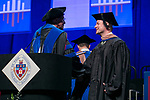 XXXXXXX right, receives the XXXXXX Award from Ray Whittington, dean of the Driehaus College of Business, Sunday, June 11, 2017, during the DePaul University Driehaus College of Business commencement ceremony at the Allstate Arena in Rosemont, IL. (DePaul University/Jamie Moncrief)