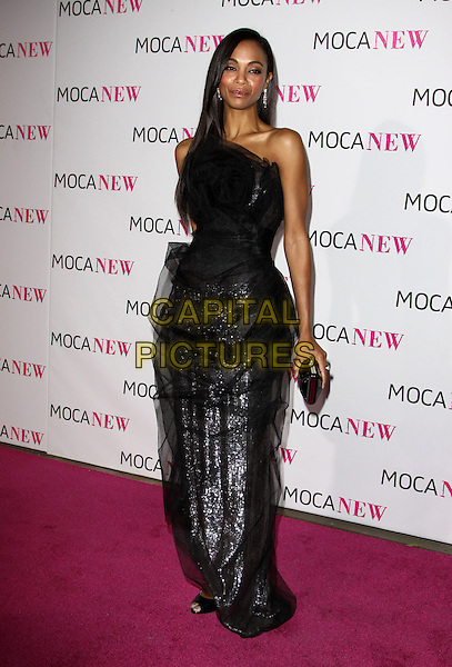 ZOE SALDANA .At MOCA's 30th Anniversary Gala held at MOCA, Los Angeles, California, USA, 14th November 2009. .full length dress black strapless tulle silver sparkly clutch bag sheer chiffon open toe christian louboutin shoes  sequined sequin .CAP/ADM/KB.©Kevan Brooks/AdMedia/Capital Pictures.