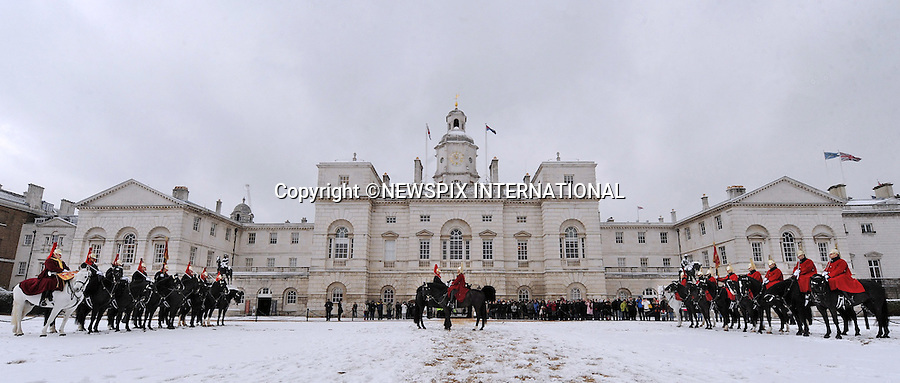 """SNOWY CHANGING OF THE GUARD.The Show Must Go On - Despite the weather the Queen's Life Guard's duties must be carried out, Horse Guards, London_2/12/2010.Photo Credit: ©Harmer_Newspix International..**ALL FEES PAYABLE TO: """"NEWSPIX INTERNATIONAL""""**..PHOTO CREDIT MANDATORY!!: NEWSPIX INTERNATIONAL..IMMEDIATE CONFIRMATION OF USAGE REQUIRED:.Newspix International, 31 Chinnery Hill, Bishop's Stortford, ENGLAND CM23 3PS.Tel:+441279 324672  ; Fax: +441279656877.Mobile:  0777568 1153.e-mail: info@newspixinternational.co.uk."""