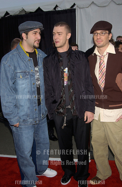 NSync stars JUSTIN TIMBERLAKE, JOEY FATONE & JC CHASEZ at the 30th Annual American Music Awards in Los Angeles..13JAN2003.  © Paul Smith / Featureflash