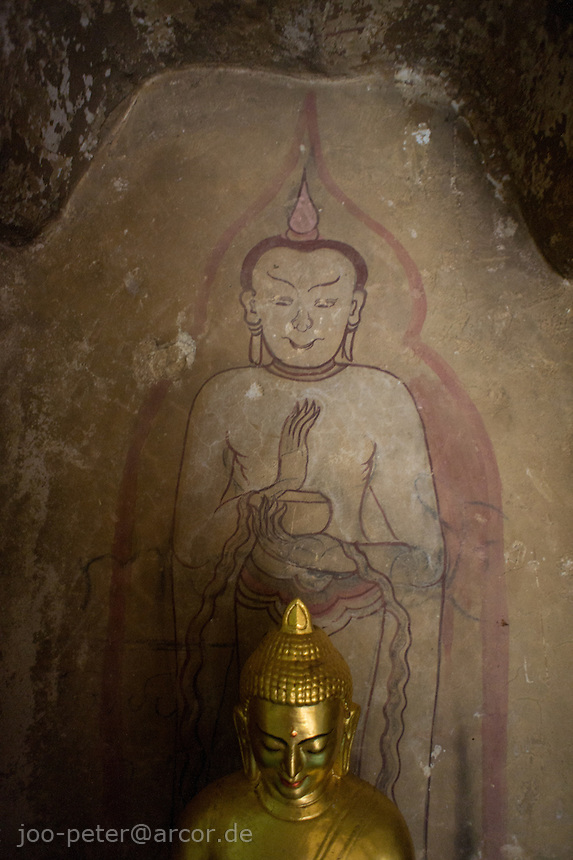 buddha sculpture with ancient wall painting, Htilominlo temple, Bagan archeological site, Myanmar
