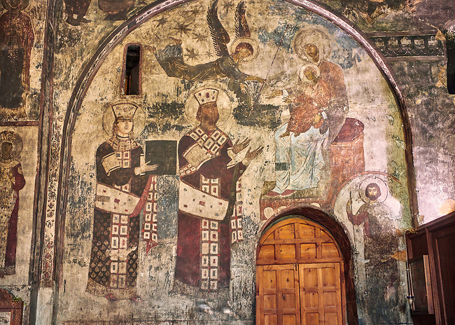 Picture & image of Vardzia medieval cave Church of the Dormition interior secco paintings of Queen Tamar & Giorgi III, part of the cave city and monastery of Vardzia, Erusheti Mountain, southern Georgia (country)<br /> <br /> Inhabited from the 5th century BC, the first identifiable phase of building took place at  Vardzia in the reign of Giorgi III (1156-1184) to be continued by his successor, Queen Tamar 1186, when the Church of the Dormition was carved out of the rock and decorated with frescoes