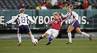 06 November,  2004.   Kristine Lilly (13) takes the ball away from Helle Nielsen (15) of Denmark at  Lincoln Financial Field in Philadelphia, Pa.