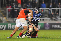 Sale Sharks Andrei Ostrikov tacked by Saracens No 1 Mako Vunipola during the European Rugby Champions Cup match between Sale Sharks and Saracens at AJ Bell Stadium, Salford, England on 18 December 2016. Photo by Paul Bell.