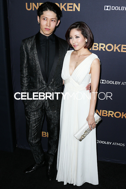 HOLLYWOOD, LOS ANGELES, CA, USA - DECEMBER 15: Miyavi, Takamasa Ishihara, Melody Ishihara arrive at the Los Angeles Premiere Of Universal Pictures' 'Unbroken' held at the Dolby Theatre on December 15, 2014 in Hollywood, Los Angeles, California, United States. (Photo by Xavier Collin/Celebrity Monitor)