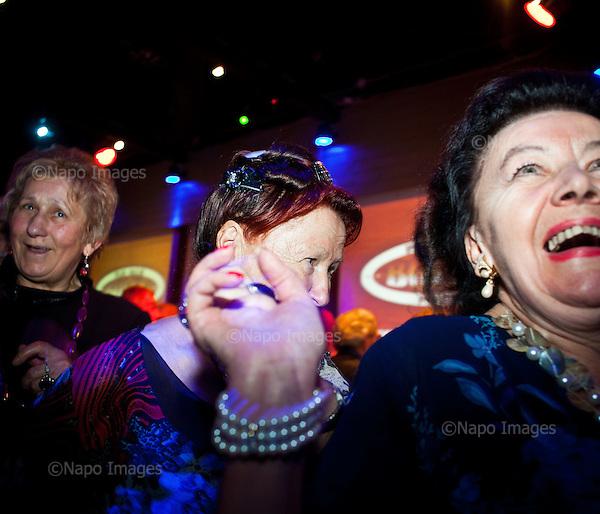 WARSAW, POLAND, NOVEMBER 2011:.Pensioners enjoying disco party run by Wika Szmyt, a 74 year old DJ..Wika is famous in Poland for being the oldest DJ. Twice a week she runs discos at the Bolek club in Warsaw, frequented mainly by the pensioners..(Photo by Piotr Malecki/Napo Images)..WARSZAWA, LISTOPAD 2011:.Emeryci bawia sie na dyskotece prowadzonej przez DJ Wike. Wika Szmyt, 74-letnia DJ jest znana jako najstarsza didzejka w Polsce. Dwa razy w tygodniu prowadzi dyskoteki w klubie Bolek, na ktore przychodza glownie emeryci..Fot: Piotr Malecki/Napo Images.***ZAKAZ PUBLIKACJI W TABLOIDACH I PORTALACH PLOTKARSKICH*** .*** Zdjecie moze byc uzyte w prasie, gdy sposob jego wykorzystania oraz podpis nie obrazaja osob znajdujacych sie na fotografii ***.
