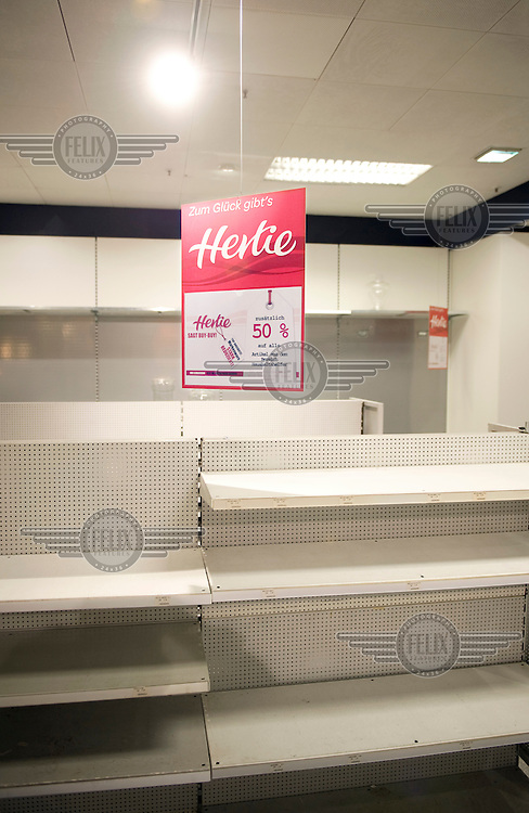 Empty shelves at a Hertie store in Berlin. After more than 100 years of selling everything from clothes to household goods, Germany's Hertie retail chain closes.