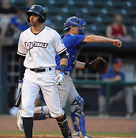 NWA Democrat-Gazette/ANDY SHUPE<br /> Northwest Arkansas Naturals designated hitter Paulo Orlando reacts after striking out as Midland Rockhounds catcher Sean Murphy throws the ball through the infield Wednesday, Aug 9, 2017, during the third inning at Arvest Ballpark in Springdale. Visit nwadg.com/photos to see more photographs from the game