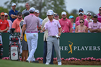 Xander Schauffele (USA) shakes hands with Jimmy Walker (USA) on 1 during round 4 of The Players Championship, TPC Sawgrass, at Ponte Vedra, Florida, USA. 5/13/2018.<br /> Picture: Golffile | Ken Murray<br /> <br /> <br /> All photo usage must carry mandatory copyright credit (&copy; Golffile | Ken Murray)